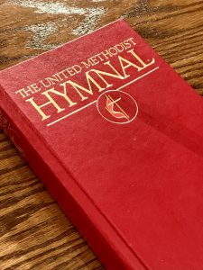 picture of a red United Methodist hymnal