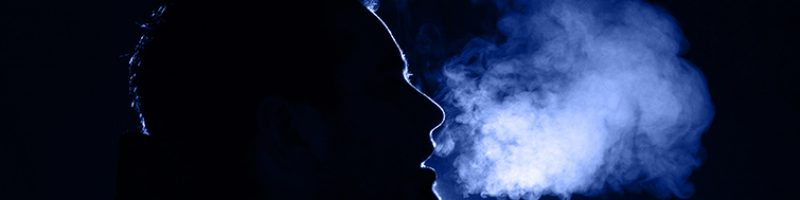 outline of a man exhaling warm breath