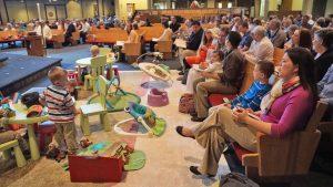 Children playing on a mat during worship
