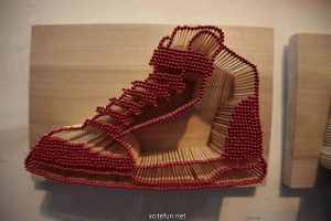 Matchsticks standing on end in a design to look like a basketball shoe