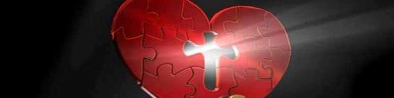 red heart-shaped puzzle; a missing piece in the middle in the shape of a cross with light shining through