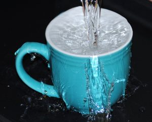 a mug overflowing with water