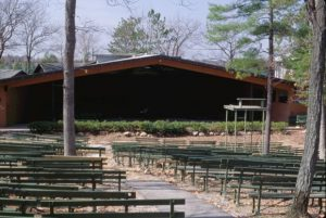 Green benches at the outdoor performance area at the Interlochen Center for the Arts.