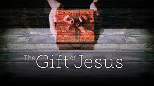 "A gift box with the text below, ""The gift of Jesus."""