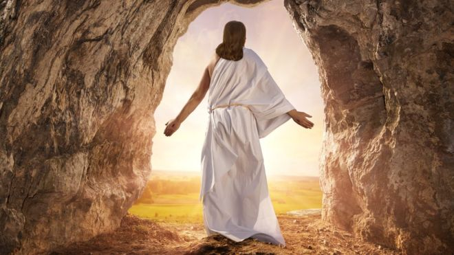 Resurrected Jesus Christ standing at the opening of his tomb