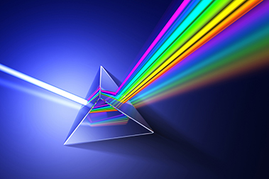 a 3-D prism showing the color spectrum going out of one side