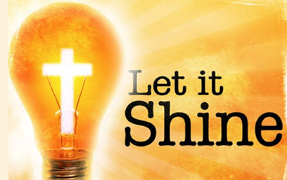 "light bulb with a white cross inside; next to it is the phrase, ""Let it Shine"""