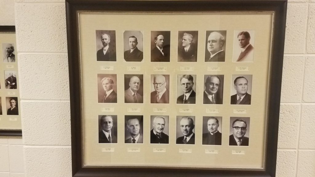 framed collection of photos of former pastors of Adrian First United Methodist Church