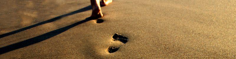 a footprint in beach sand
