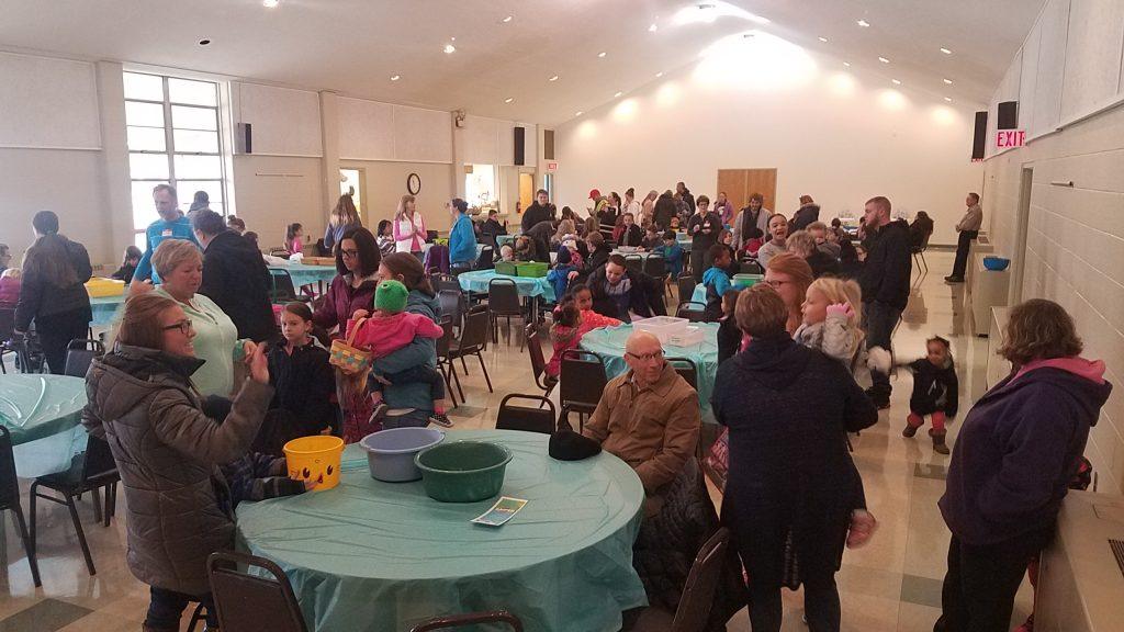 crowd of people in a church fellowship hall