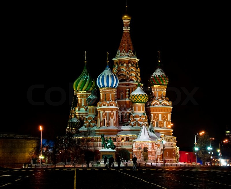 photo of a large cathedral with multi-colored domes
