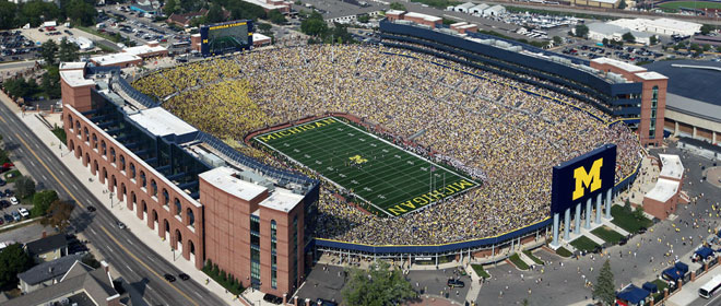 The Michigan Football Stadium, an outdoor oval-shaped football stadium that holds over 110,000 people.