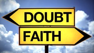 a sign pointing in opposite directions, 'doubt' to the left, 'faith' to the right